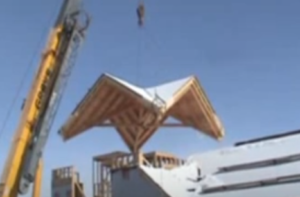 Crane Lifting a Roof