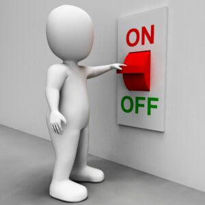 Person Turning Off a Light Switch